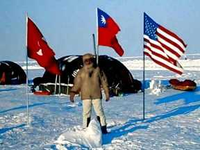 Standing on the north pole at Camp Borneo